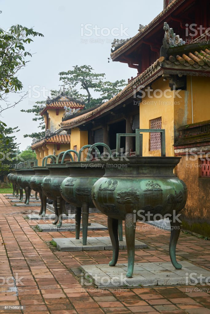 Nine mess urn from an emporer of Vietnam in the imperial city, Hue, Vietnam. stock photo