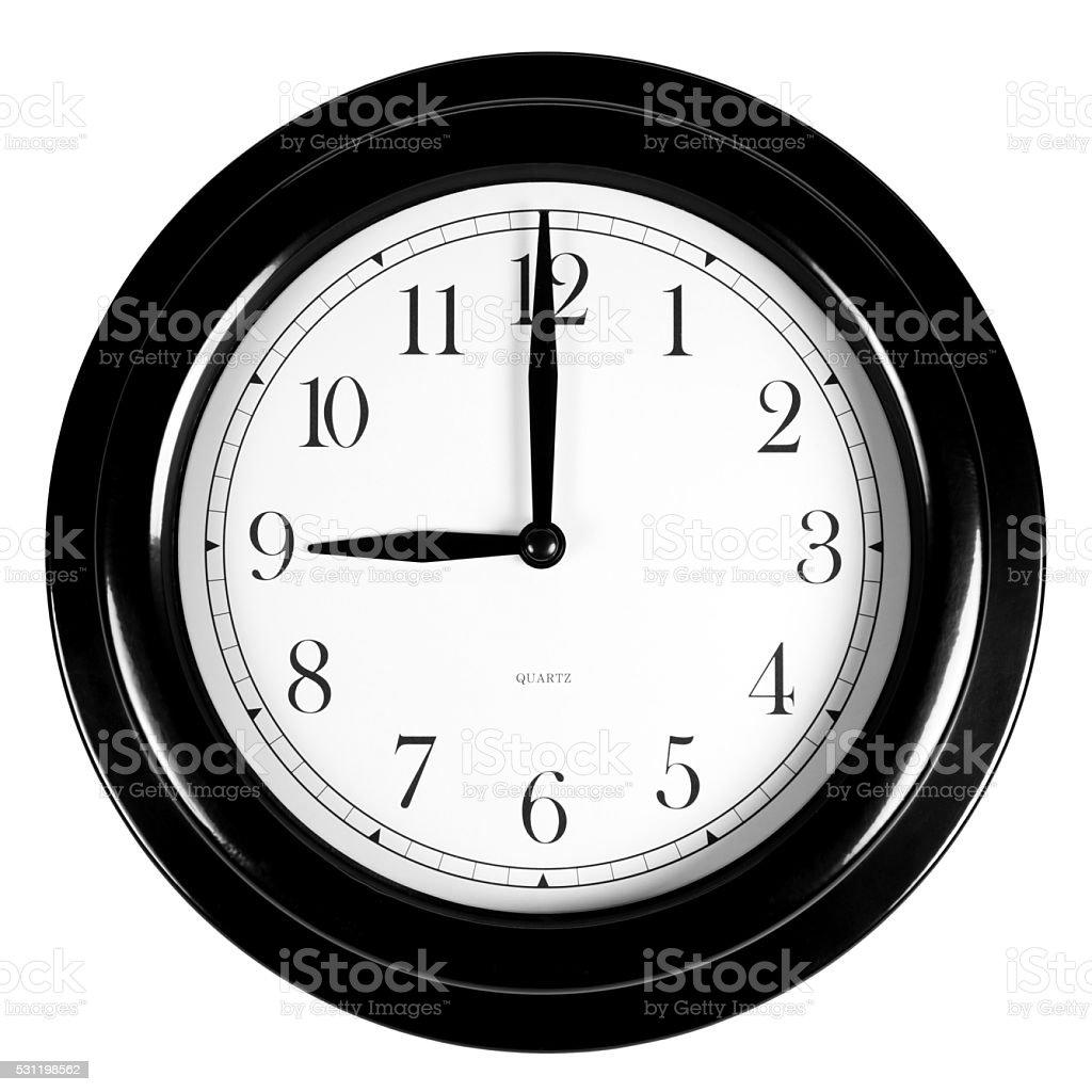 Nine o'clock on the black wall clock stock photo