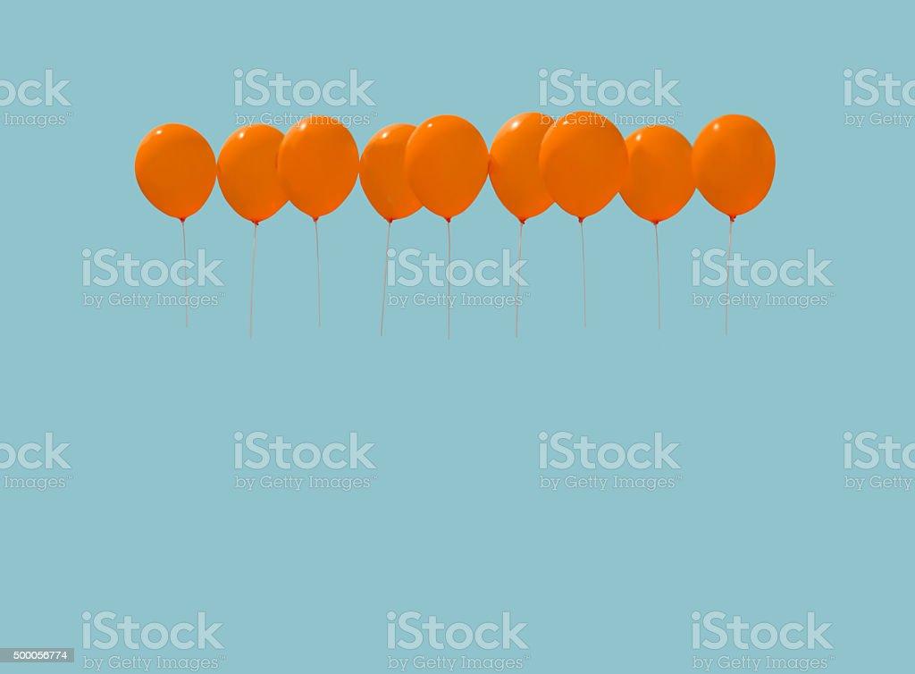 Nine orange balloons stock photo