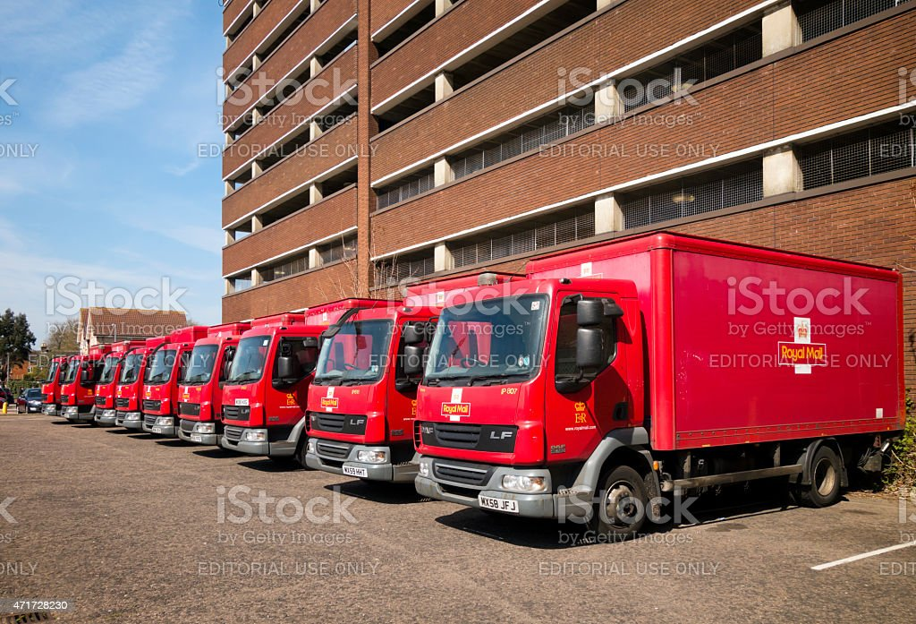 Nine red Royal Mail vans parked stock photo