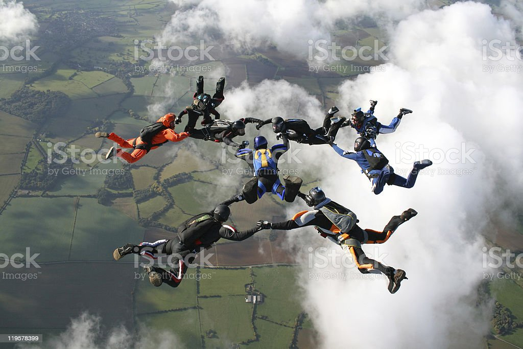 Nine skydivers in freefall stock photo