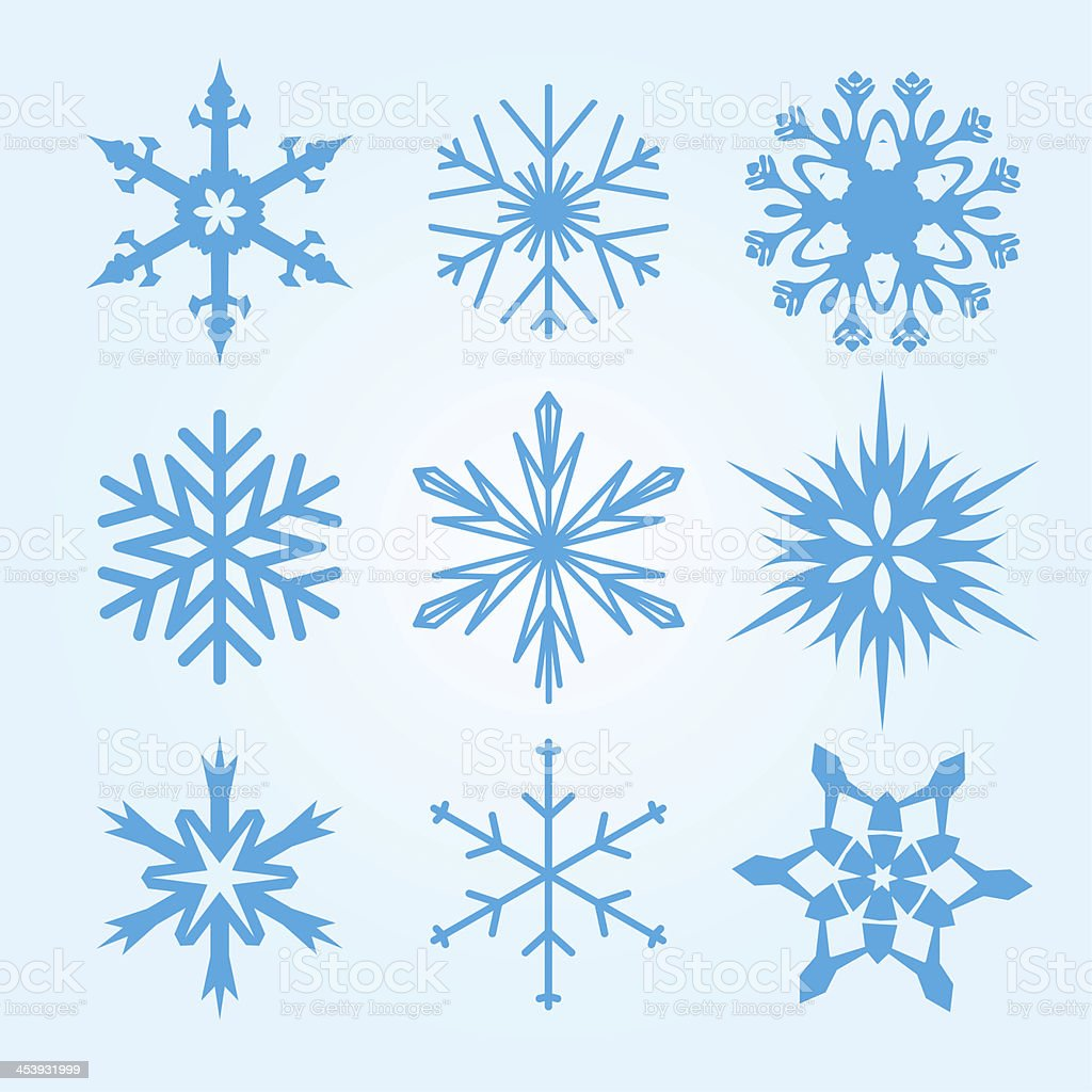 Nine vector illustrations of snowflakes in different designs stock photo