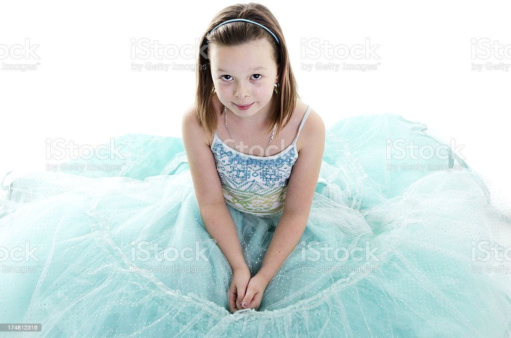 Nine year old girl in sparkly dress looking up. stock photo
