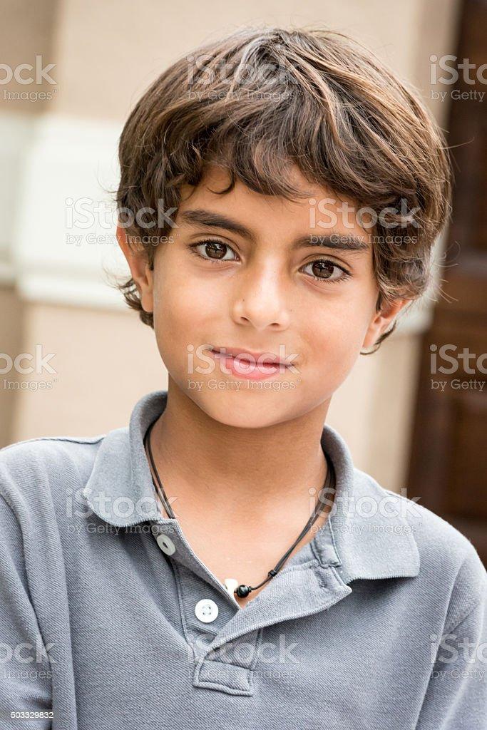 Nine years old little boy stock photo