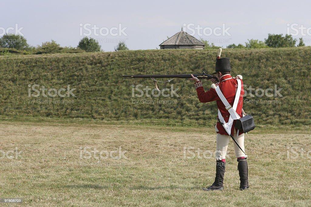 Nineteenth century British soldier preparing to fire royalty-free stock photo