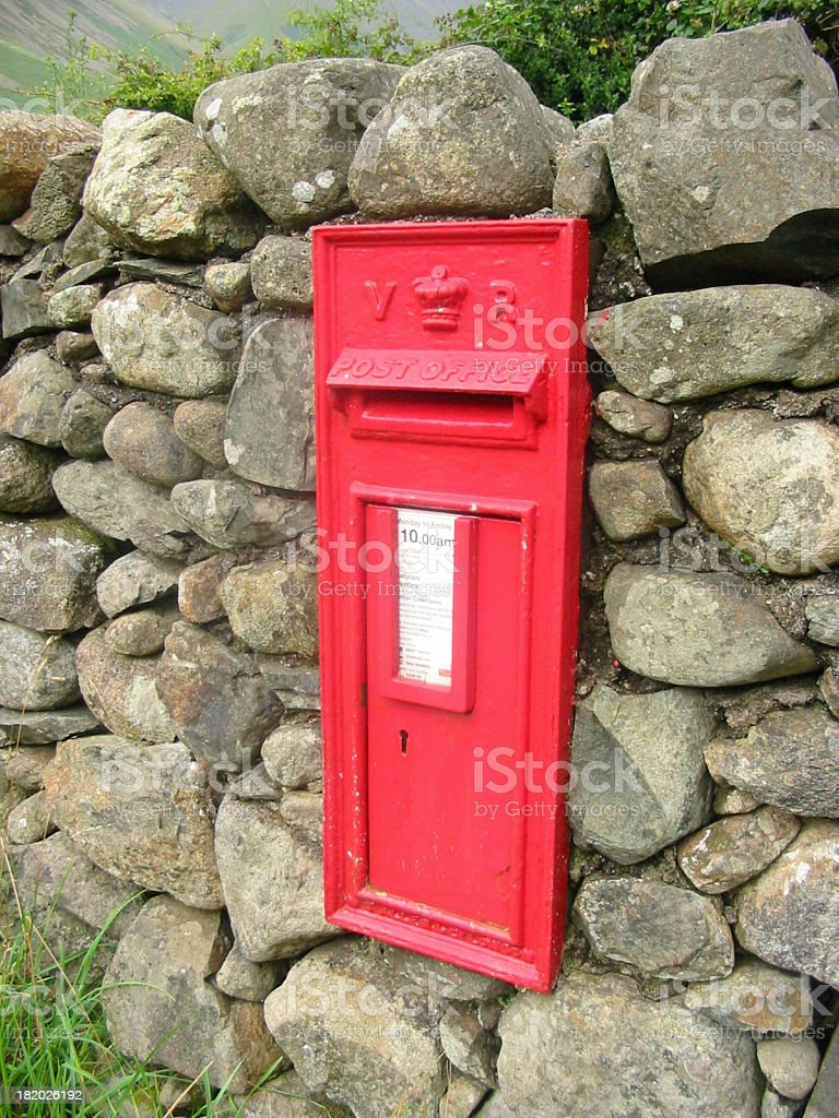 Victorian postbox set in stone wall stock photo