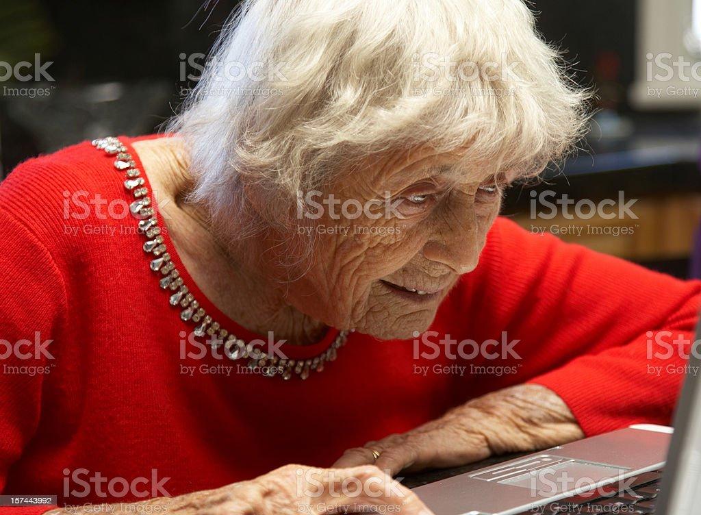Ninety year old lady on laptop royalty-free stock photo