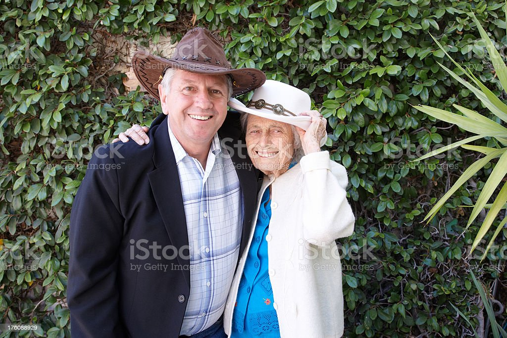 Ninety year old lady with younger mature man royalty-free stock photo