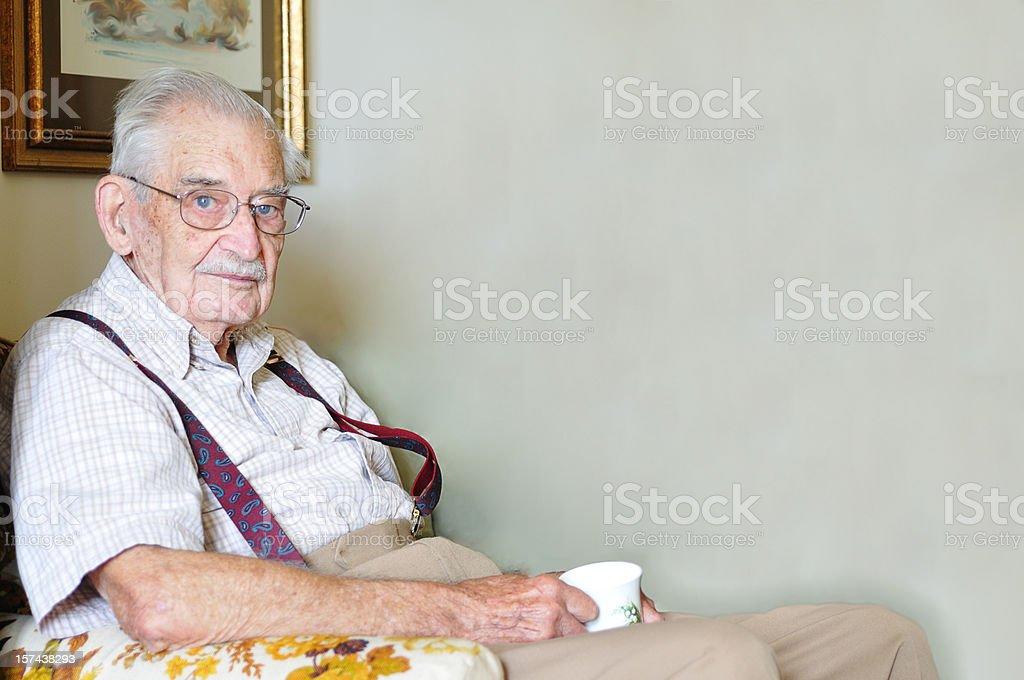 ninety year old man with mug of tea stock photo