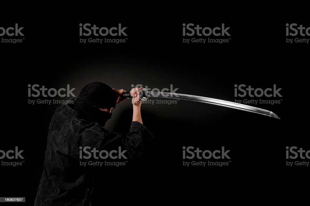 Ninja assassin, black background stock photo