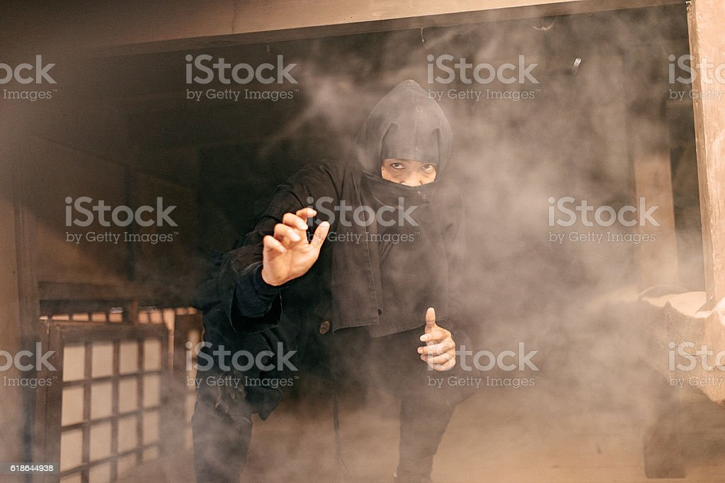 Ninja hiding in the shed stock photo