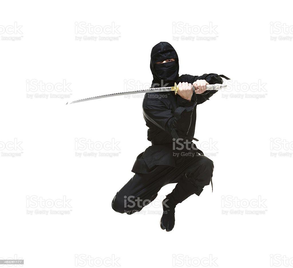Ninja in action with sword stock photo