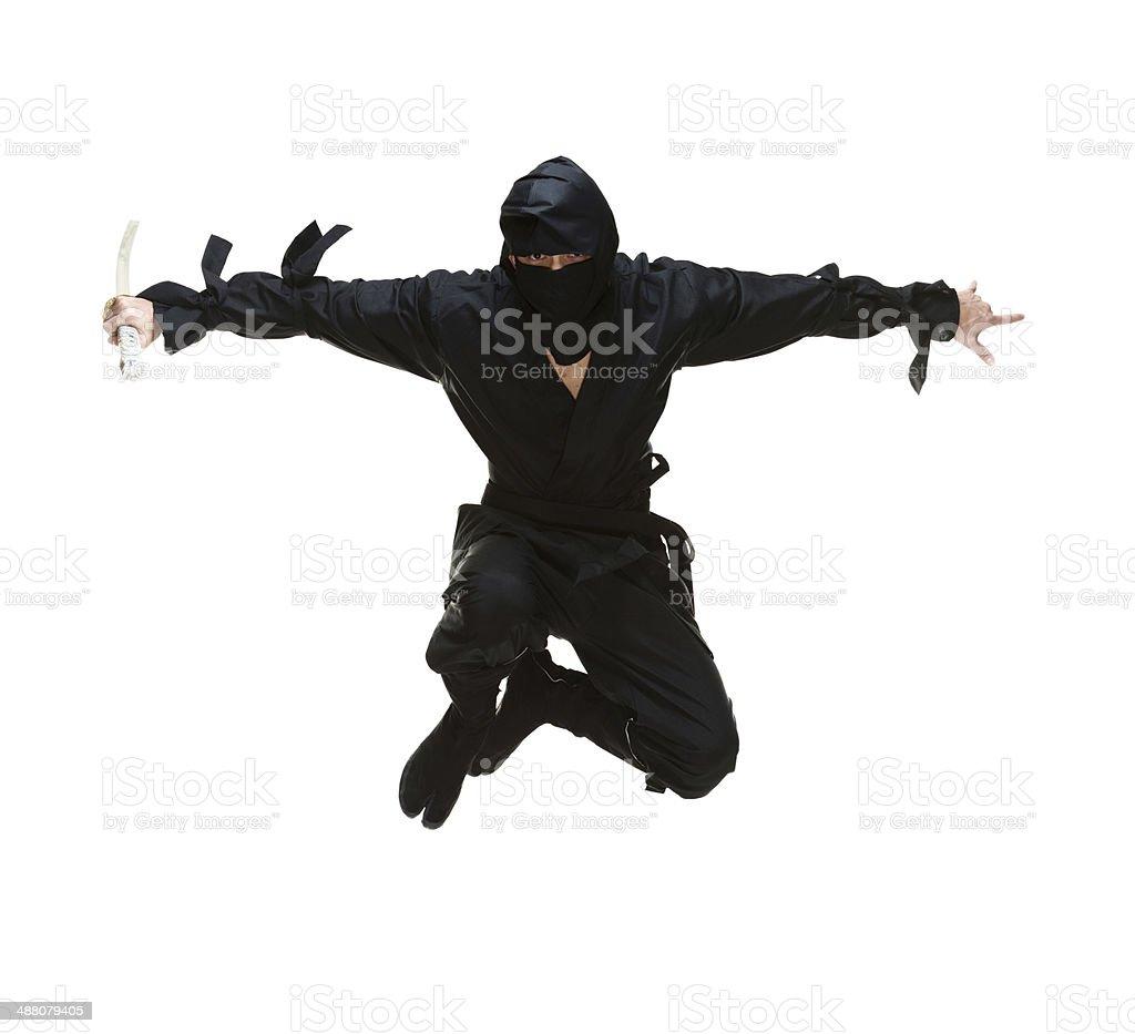 Ninja jumping and holding sword stock photo