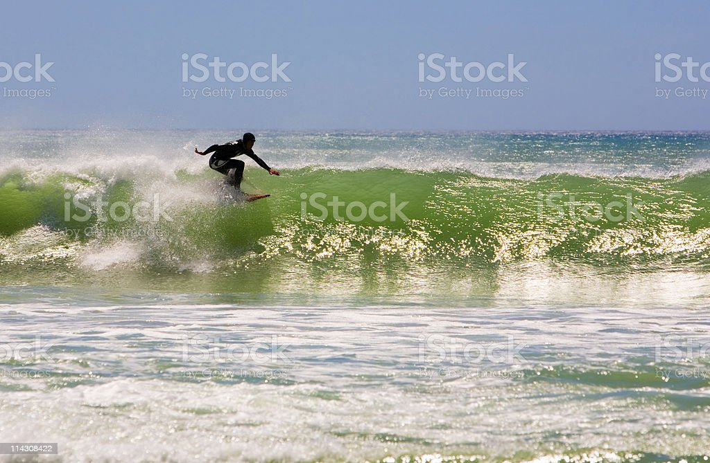 Ninja surfer stock photo