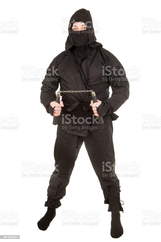 Ninja with nunchaku stock photo