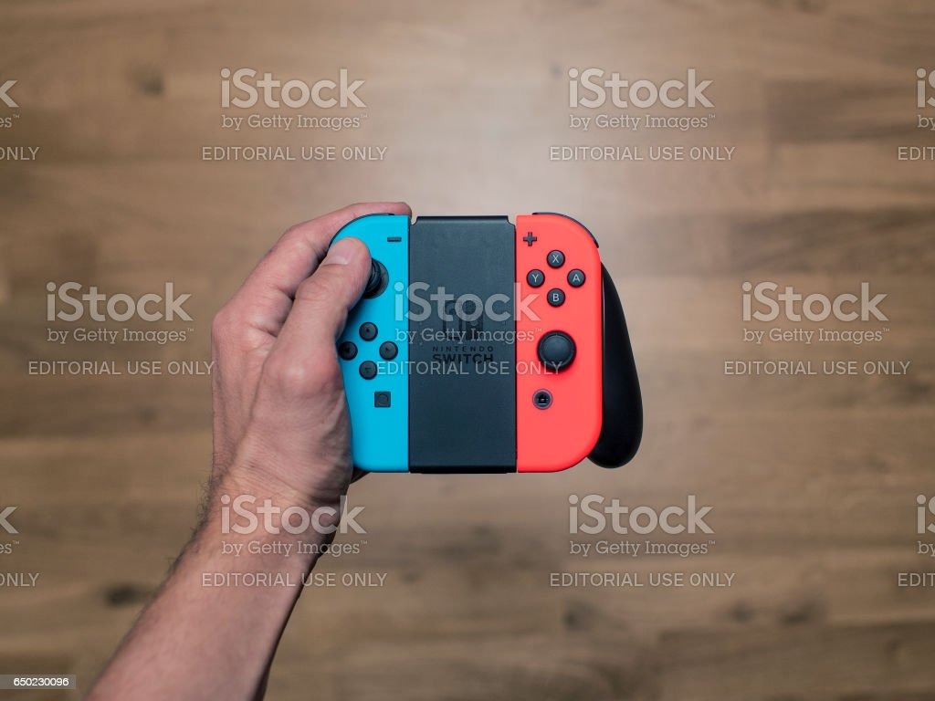 Nintendo Switch neon Game Controller stock photo