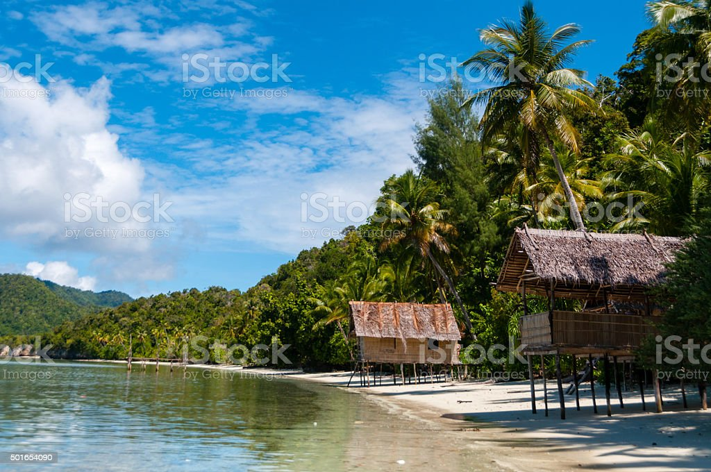 Nipa bamboo Huts at the White Sand beach with palm stock photo