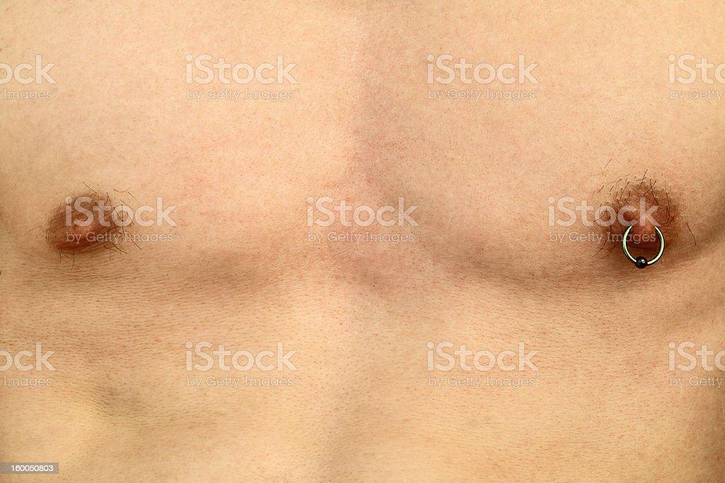 Nipple piercing stock photo