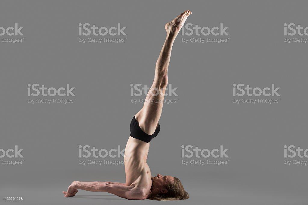 Niralamba Sarvangasana yoga pose stock photo