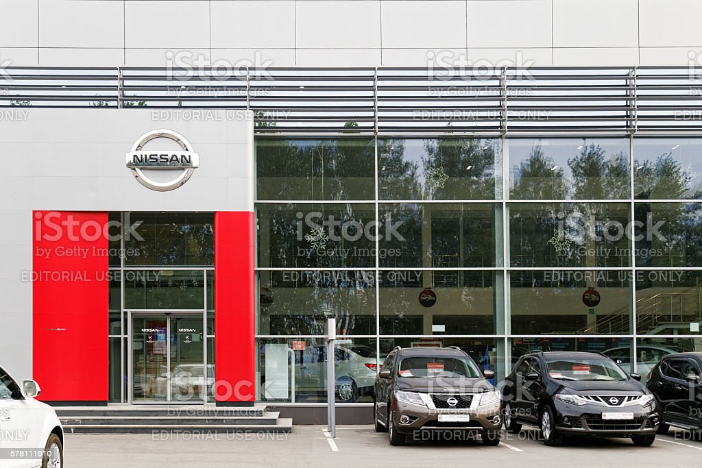 Nissan car selling and service center with Nissan sign. stock photo