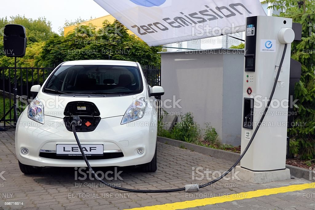Nissan Leaf on the electric charging point stock photo