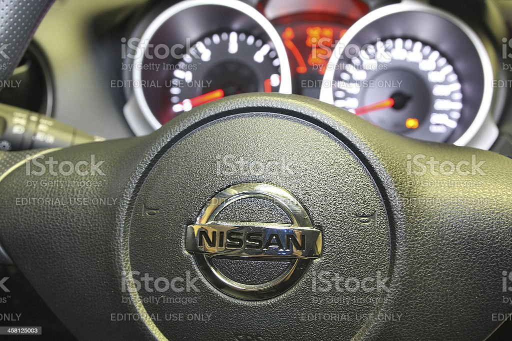 Nissan logo on a car steering wheel stock photo