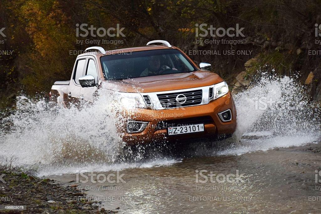 Nissan NP300 Navara in a river stock photo