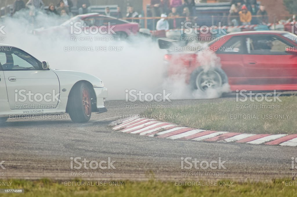 Nissan PS13 and S14 tandem drifting royalty-free stock photo