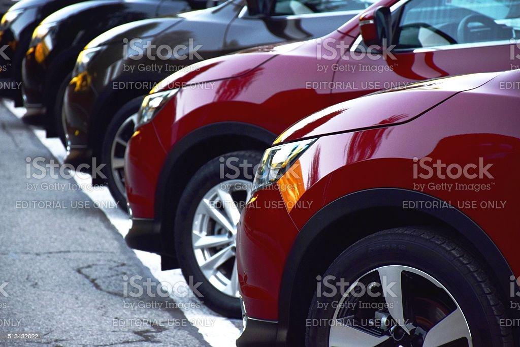 Nissan Qashqai vehicles on the parking stock photo