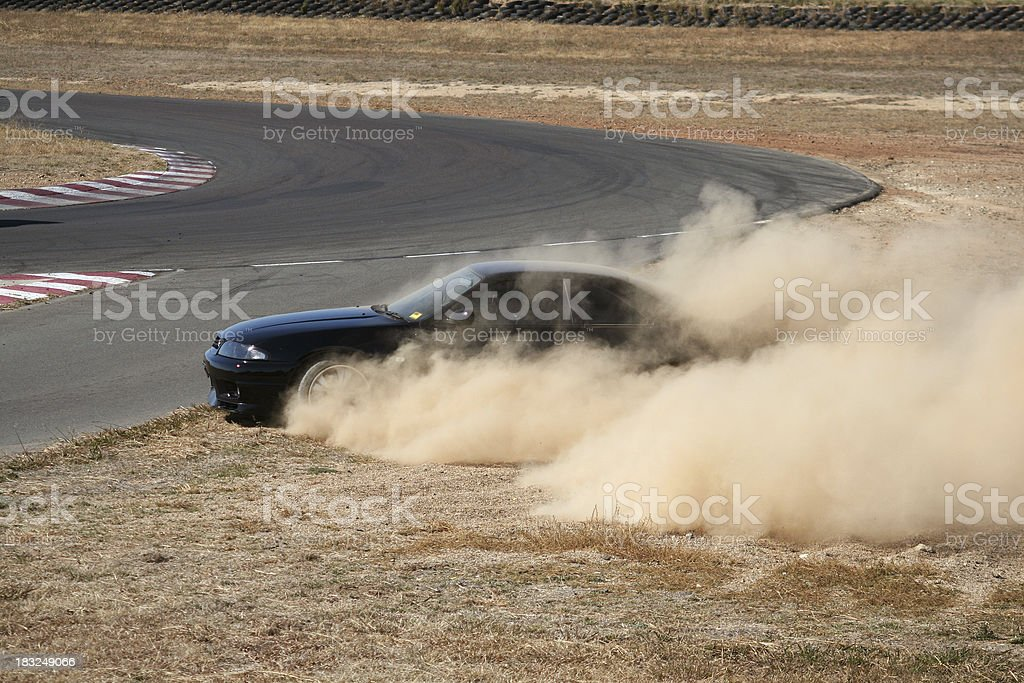 Nissan R33 GTR losing control on racetrack [4/4] stock photo