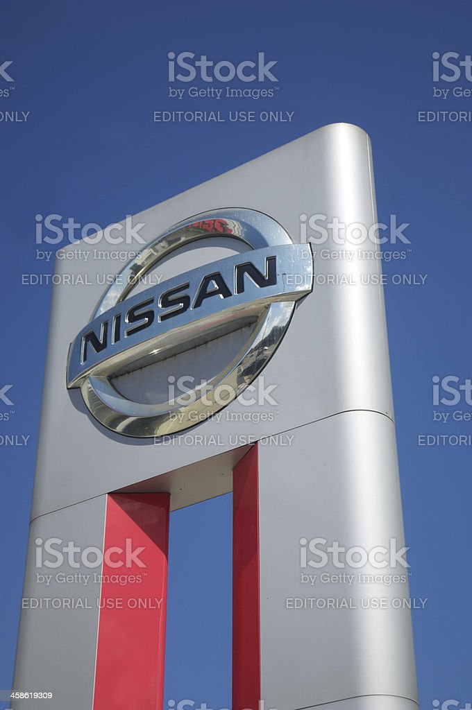 Nissan sign against Blue sky stock photo
