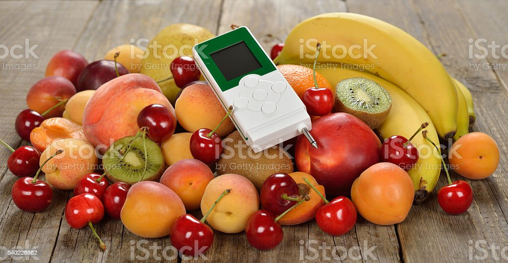 Nitrate tester and various fruits stock photo
