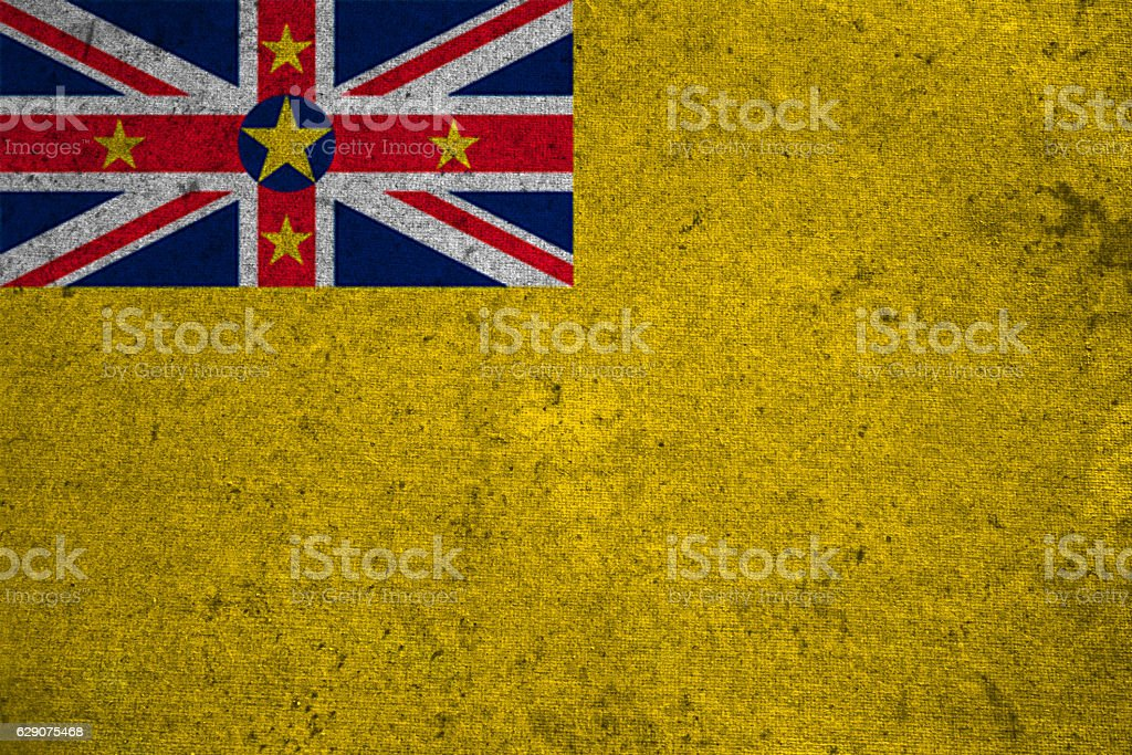 niue flag on an old grunge background stock photo
