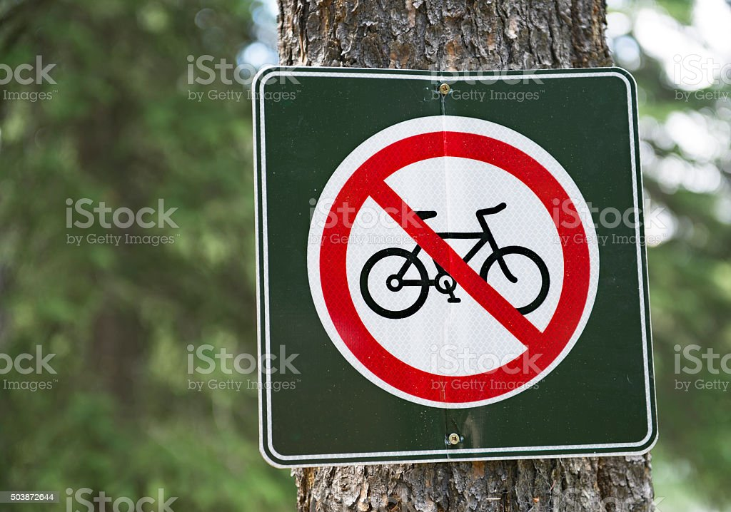 No cycling sign on a tree trunk stock photo