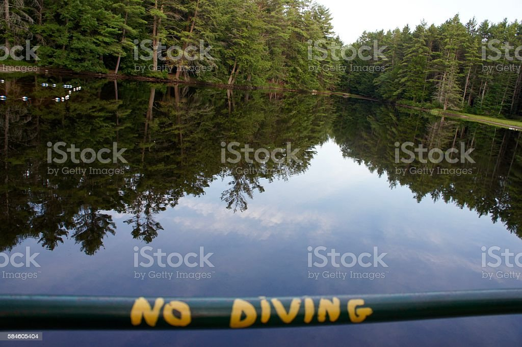 No Diving Painted on Railing on Bridge over River stock photo