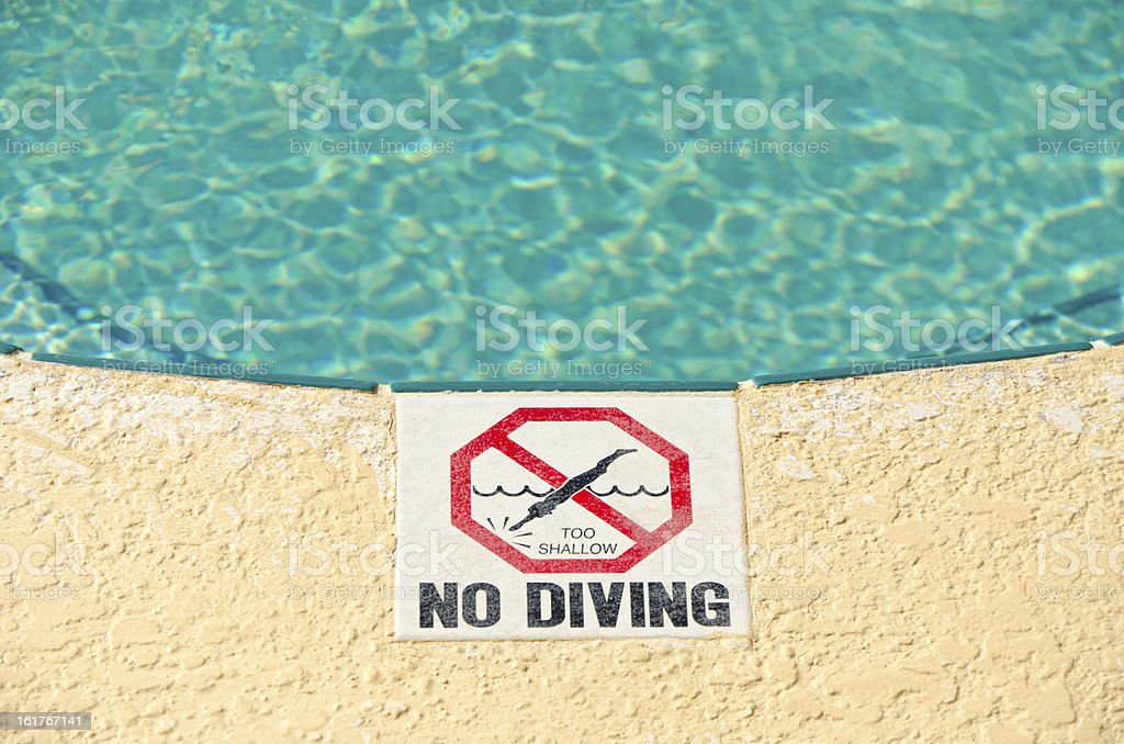 No Diving Sign at Swimming Pool Edge stock photo