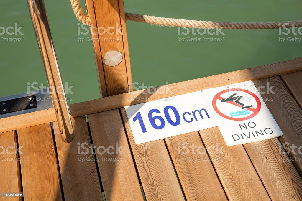 no diving warning sign stock photo