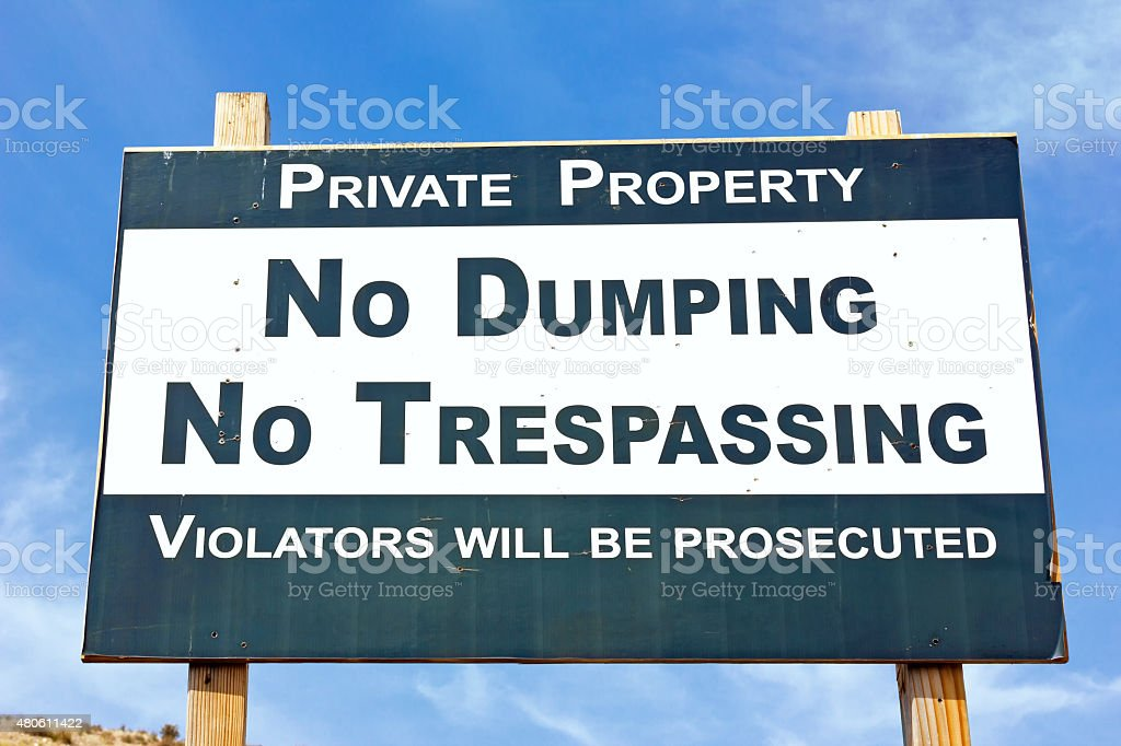 No Dumping No Trespassing stock photo