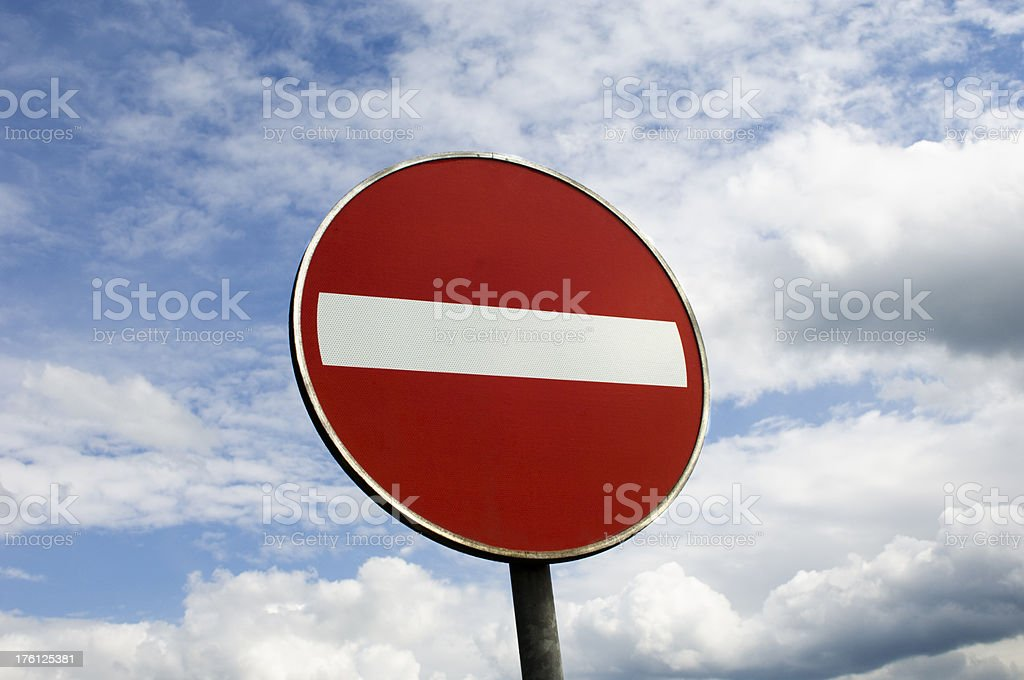 No Entry Sign Against a Blue Sky Background royalty-free stock photo