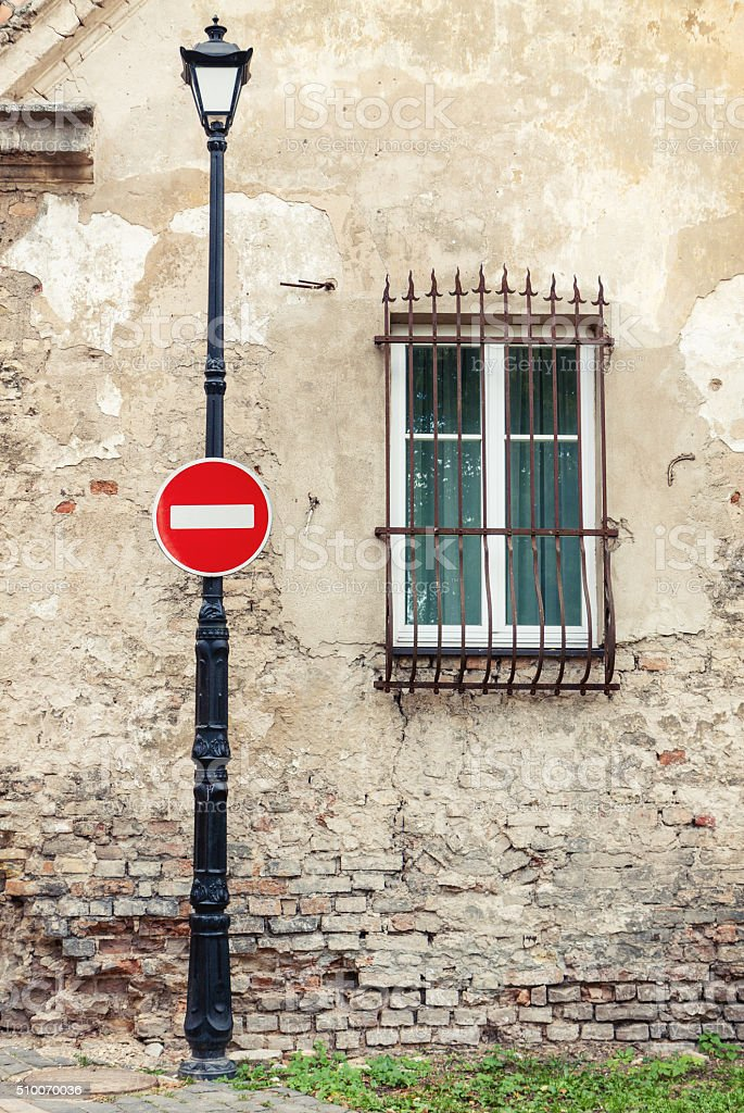 No entry sign hanging on lamp post stock photo