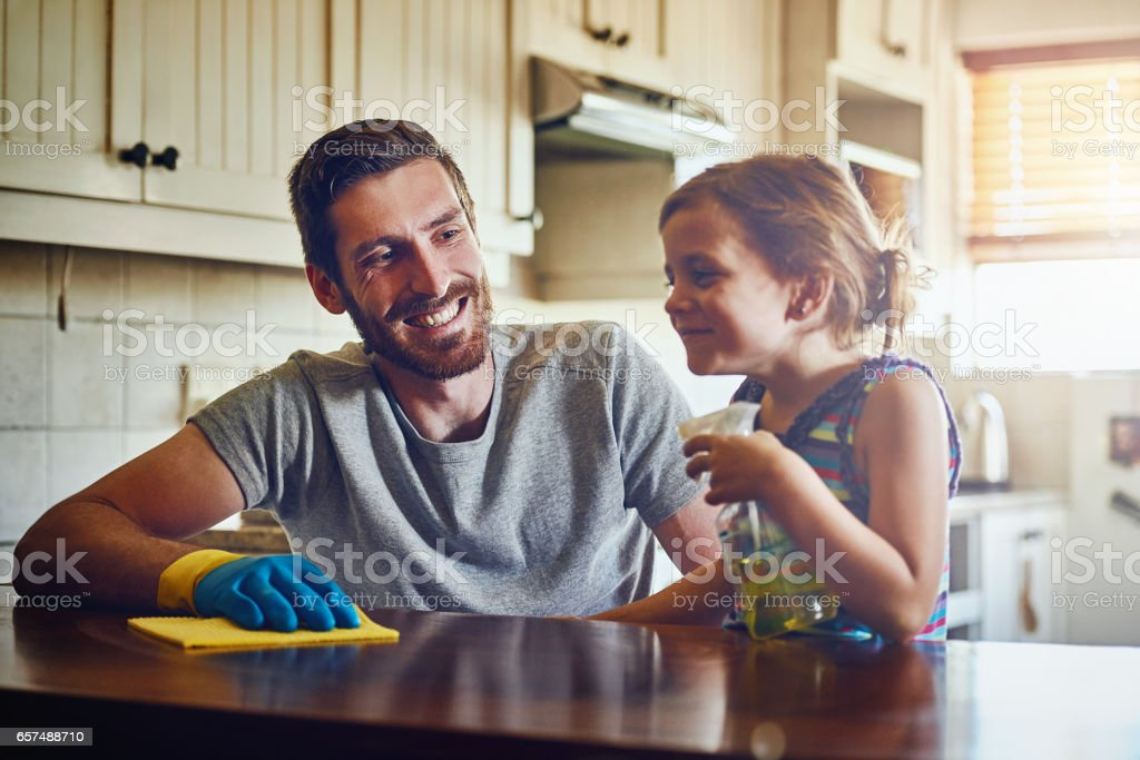 No hassles with housework thanks to Dad's little helper stock photo