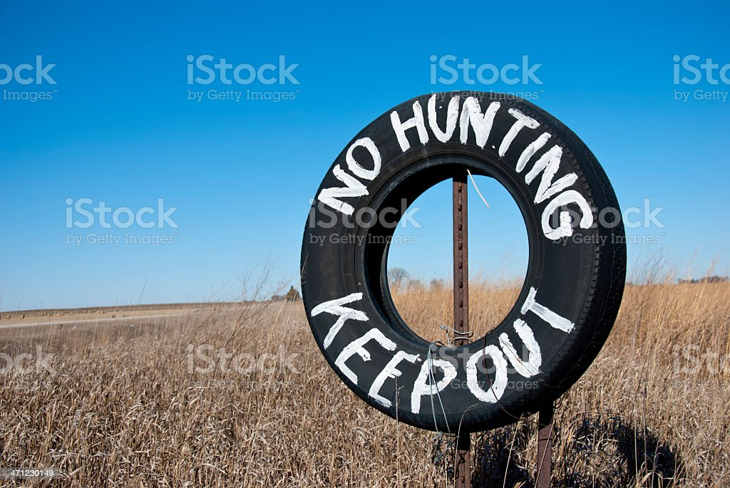 No Hunting Keep Out Tire Sign stock photo