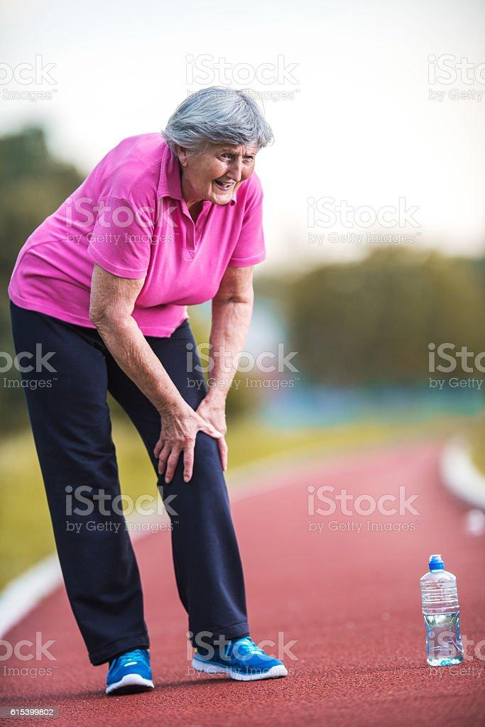 No, I have hurt my knee! stock photo