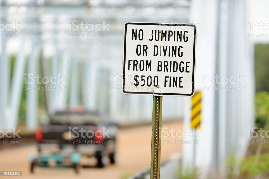 No jumping or diving from bridge sign stock photo