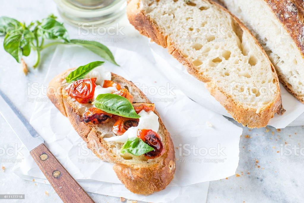 No knead rustic white bread recipe on white paper stock photo