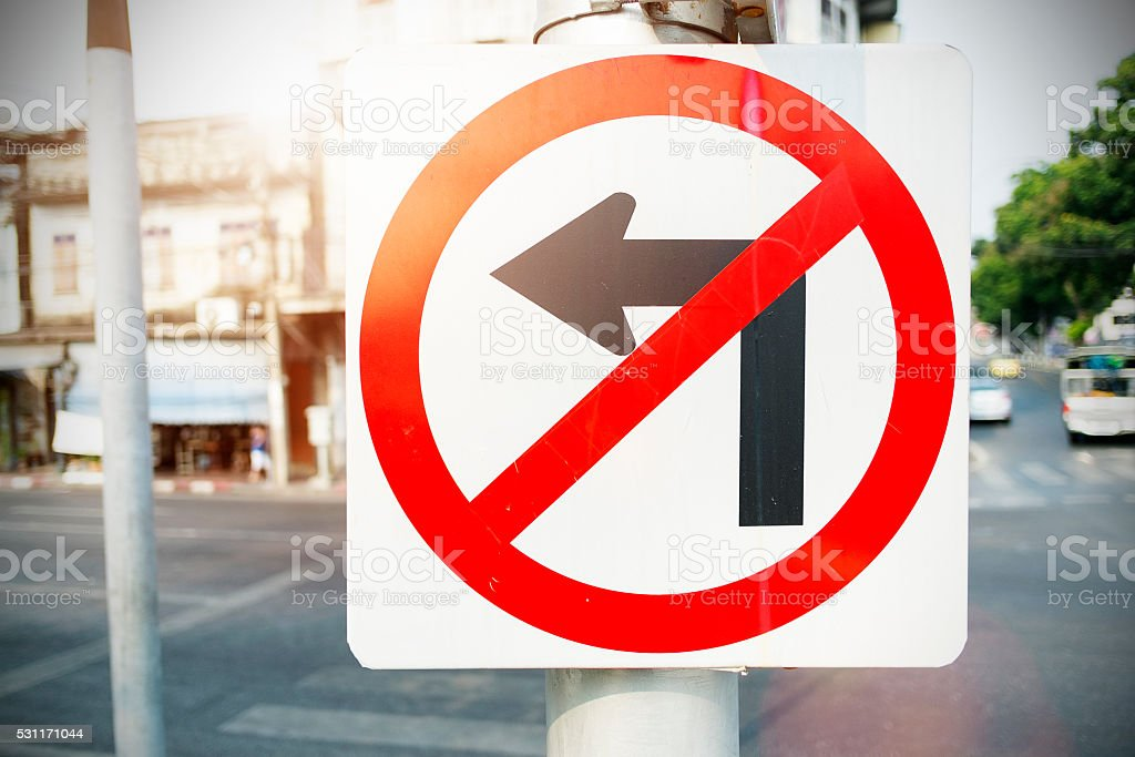 No Left Turn Sign with natural background stock photo