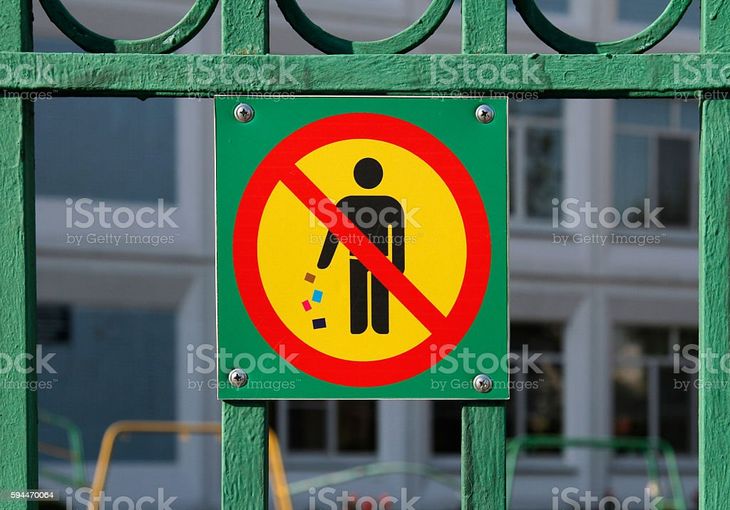 No littering sign in green background on fence stock photo