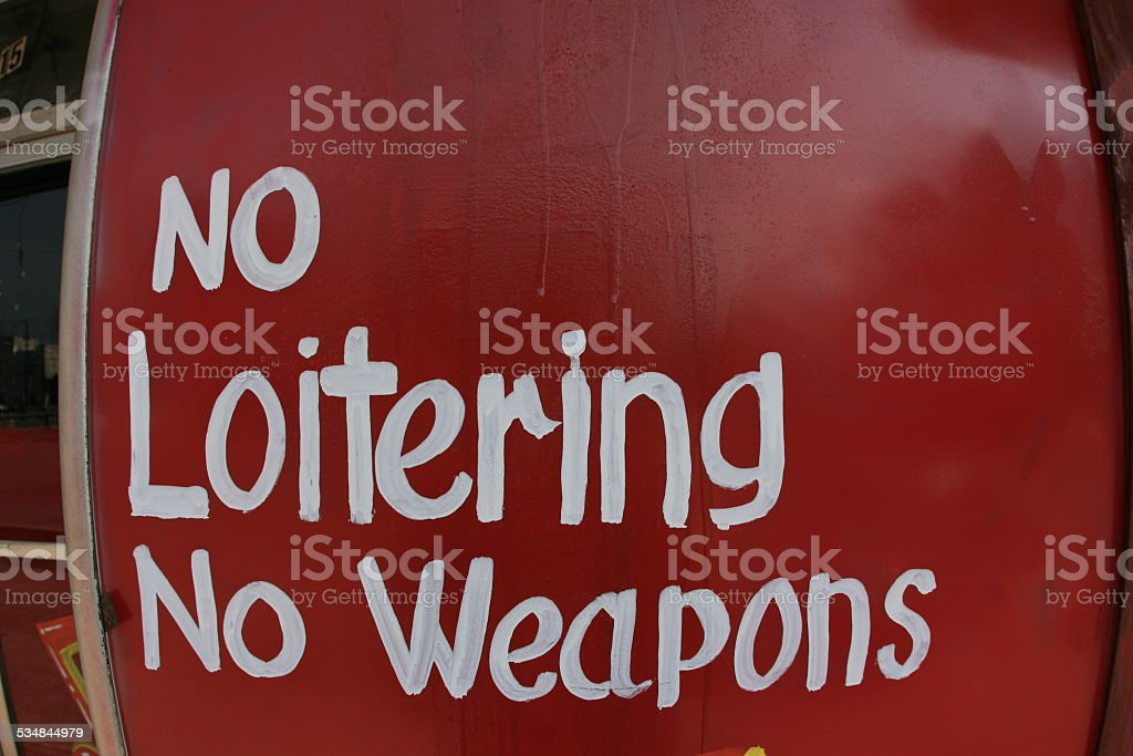 No Loitering No Weapons stock photo