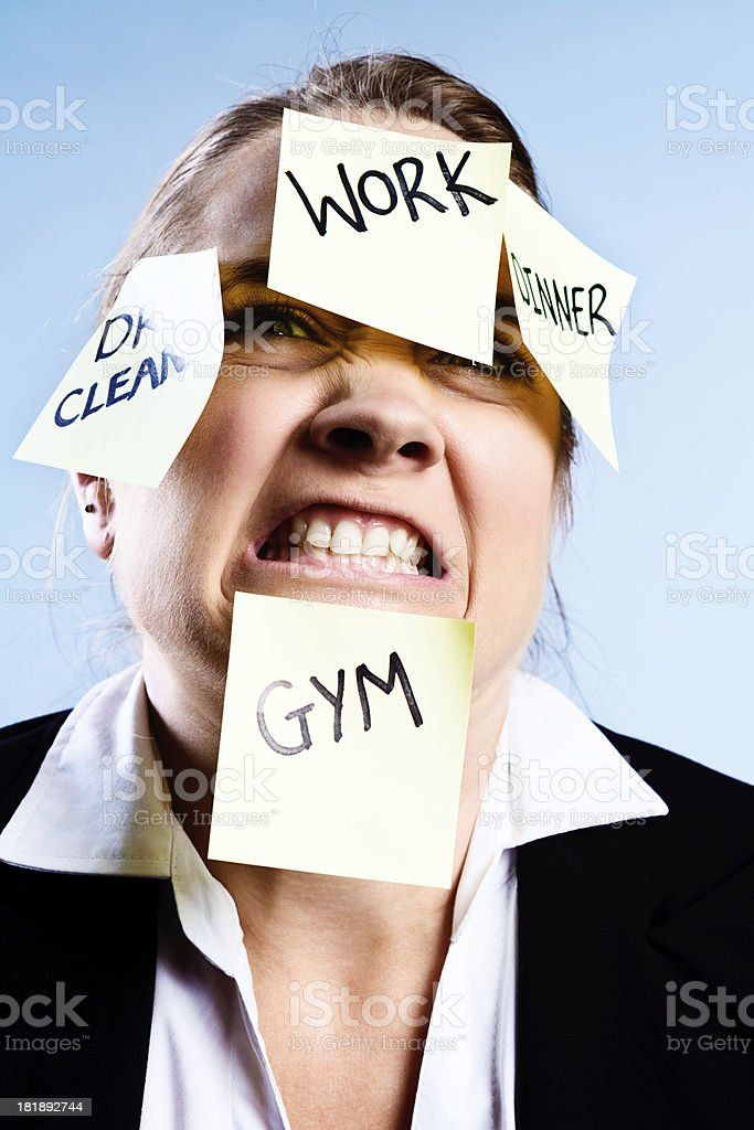 No more! Over-tasked woman covered in job reminders royalty-free stock photo