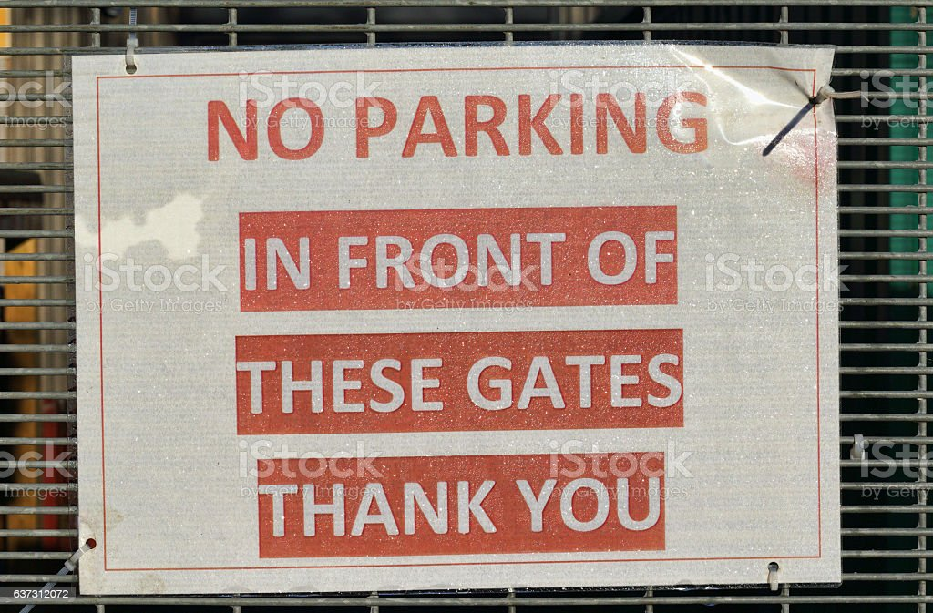 No parking in front of gates written sign stock photo